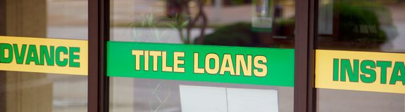 Title Loan Sign. An advertisement sign from fast quick cash car title loan and instant cash mart royalty free stock photography