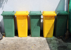 Green and Yellow Trashcan Stock Images