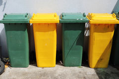Green and Yellow Trashcan Stock Photos