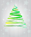 Green yellow tree flare concept in snowfall Royalty Free Stock Image
