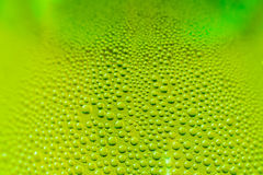 Green yellow water drops Royalty Free Stock Photography