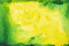 Green and yellow watercolor background. On embossed paper with blue dots . Abstract watercolor pattern Royalty Free Stock Photo