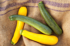 Green and yellow zucchini at the farm market Stock Photography