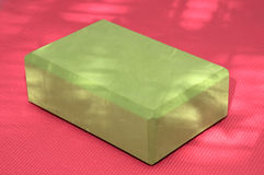 Green yoga block pink mat Stock Photos