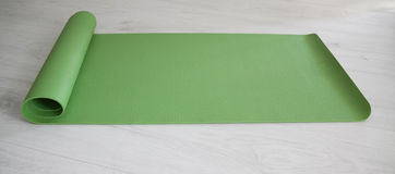 Green yoga carpet Royalty Free Stock Photos