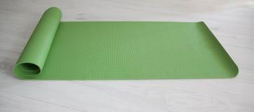 Green yoga carpet Royalty Free Stock Photos