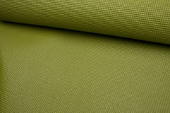 Green Yoga Exercise Mat Stock Photo