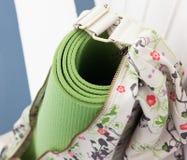 Green yoga mat in the bag Stock Photos