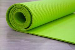 Green yoga mat Royalty Free Stock Images