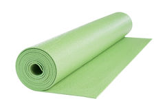 Green yoga mat, includes clipping path. Royalty Free Stock Photography