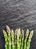 Asparagus sprouts on the black background. stock photo