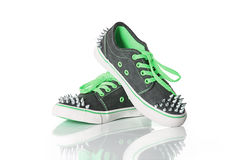 Green young girl shoes Stock Photos