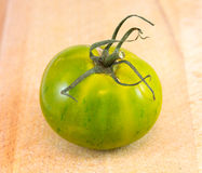 Green Zebra tomato on chopping bord Stock Photography