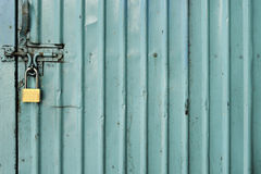Green zinc Door with key locked photo Royalty Free Stock Images