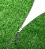 Green Zipper with Grass Stock Photo