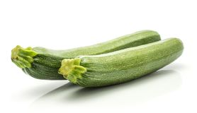 Fresh Green Zucchini isolated on white. Green zucchini isolated on white background two long raw courgettes Royalty Free Stock Images