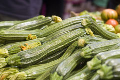 Green zucchini. In pile at farmers market stock images