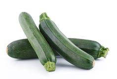 Green zucchini on white background Stock Photos