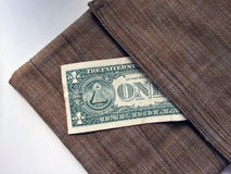 The greenback is in a safe place. One dollar peeking out of surface-mounted pocket-bags Stock Photography
