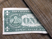The greenback is in a safe place. One dollar peeking out of surface-mounted pocket-bags Stock Image