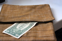 The greenback is in a safe place. One dollar peeking out of surface-mounted pocket-bags Royalty Free Stock Photography