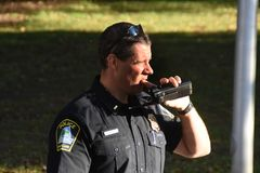 A policeman talks on the radio royalty free stock photos