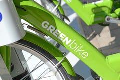 GREENbike是给予人们能承受和不伤环境的运输选择的自行车份额节目 免版税库存照片