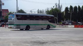 Greenbus company bus route Maesai and Maesot. CHIANGMAI, THAILAND - MAY 24 2012 : Greenbus company bus route Maesai and Maesot. Footage at Chiangmai Bus Terminal stock footage
