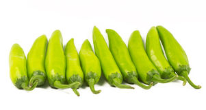 GreenChillies (Jalapenos). Green chillies (Jalapenos) arranged in a row on white background Stock Image