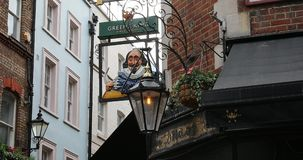 Greene King Brewery Sign Above A Pub. London, UK, June 1, 2019: Greene King Bury St Edmunds Brewery Sign Above A Pub In London England, United Kingdom, Europe stock footage
