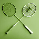 Greenery badminton racket. Green badminton racket on green background. Creative fashion sports series. Greenery Pantone color of the year 2017 Royalty Free Stock Images