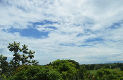 Greenery and clouds in the Philippines Royalty Free Stock Photos