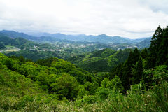 Greenery mountain panorama and town view from afar Royalty Free Stock Photography