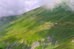Greenery mountain under clouds. Green meadow in mountain under cloudy sky Royalty Free Stock Photography