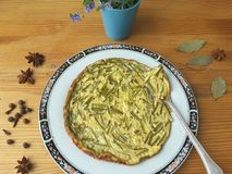 Greenery omelette with dandelions stalks and spices Royalty Free Stock Image