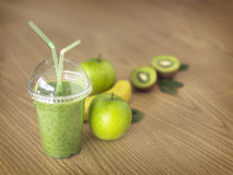 Greenfruit smoothie on wooden background Royalty Free Stock Images