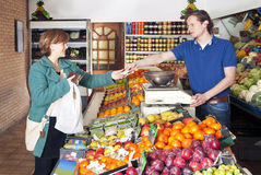 At the Greengrocer Stock Images