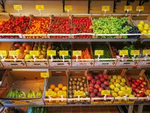 Greengrocer inside a shop. Fruit exposed on shelves, variety of colors. Stock Photo