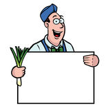 Greengrocer with leek and sign. Greengrocer holding a fresh leek and a sign Royalty Free Stock Photos