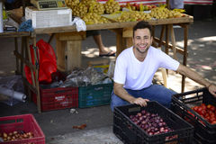 A greengrocer selling organic fruits. Stock Photos