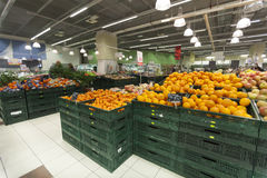 Greengrocer store. Oranges in the foreground. Greengrocer store in a new market in Rome (Italy). Many oranges in the foreground royalty free stock photo