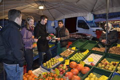 Greengrocery. German young people buy fruits Stock Image