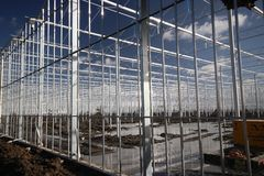Greenhouse construction in progress in Moerkapelle where a rose nursery is builded. Greenhouse construction in progress in Moerkapelle where a rose nursery is royalty free stock image