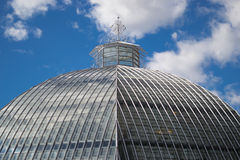 Greenhouse. Dome shaped greenhouse with blue sky and clouds in the background. Global warming concept Stock Photos