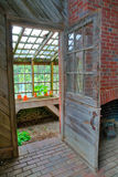 Greenhouse Door. Opening up to potting shed royalty free stock image