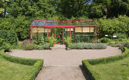 Greenhouse Driveway. Driveway to tidy greenhouse in lush soundings stock photography