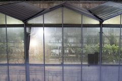Greenhouse enclosure. Greenhouse enclosure used to grow plants in a controlled environment stock photo