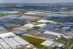 Greenhouse farming from above. Greenhouse farming on the fields of The Netherlands Royalty Free Stock Image