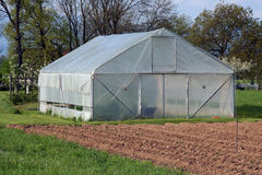 Greenhouse on the field Stock Image