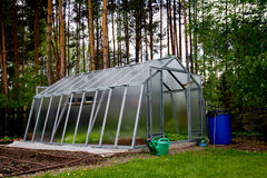 Greenhouse by the forest. A small greenhouse by the forest Royalty Free Stock Photography